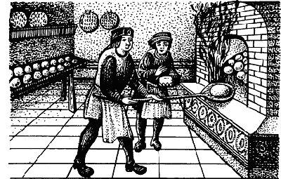 Пекарь загуржает хлеб в печь